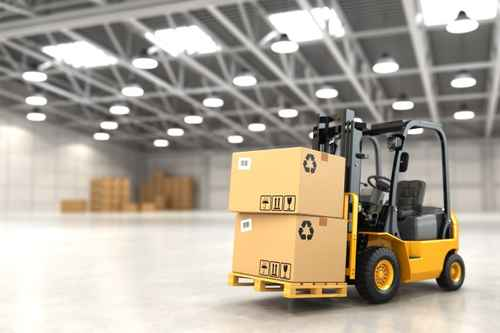 Forklift truck in warehouse or storage loading cardboard boxes.